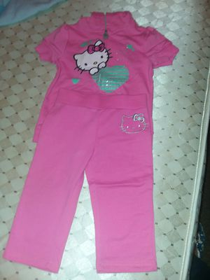 Girl clothes hello kitty suite with pants color pink sweater color white both size 5 for Sale in Columbus, OH
