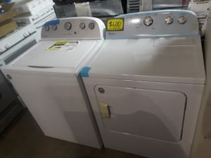 New scratch and dent Whirlpool top load washer and dryer set excellent condition 6 months warranty for Sale in Baltimore, MD