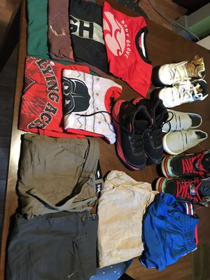 clothes for young man some clothes are new. size 14. 16. 10. basically serious for a young person from 8 to 10 years old. shoes size 7 6. and 6.5. for Sale in Jetersville, VA