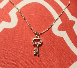 Two charms, $15: Sterling Silver key & Children's Volleyball bracelet for Sale in Bothell, WA