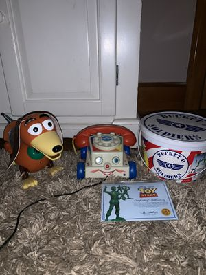 Toy Story Slinky Dog, Chatter Phone, and Collection Bucket O Soldiers for Sale in Cranston, RI