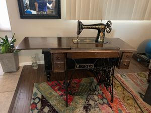 Antique Singer sewing machine in original cabinet . Bobbins & foot lever cord included for Sale in Henderson, NV