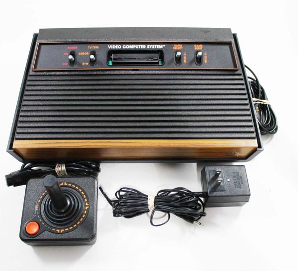 Original Atari system, with joysticks, paddles, and cables included.