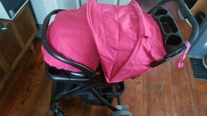 Graco snugride 30 click connect car seat with base / travel system for Sale in Elyria, OH