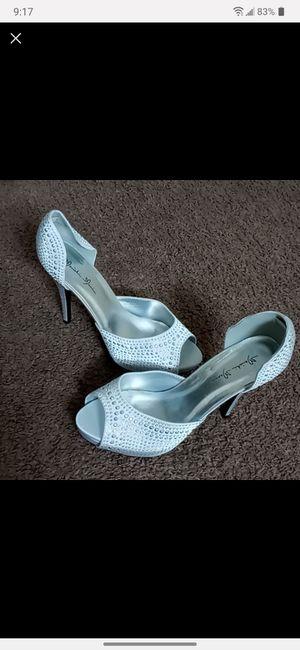 Heels silver shoes for Sale in Dearborn, MI