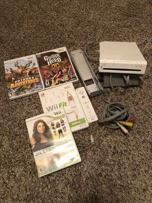 Nintendo WII - includes controller and four games for Sale in San Diego, CA