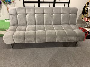 Silver Plush Futon That Can Be Used As A Sleeping Bed Or Upscale