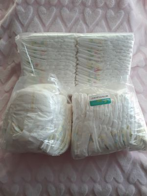 84 Newborn diapers and some mittens and 2 maternity shirts for Sale in Victorville, CA