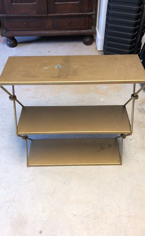 Wall-mountable gold metal shelf for Sale in Atlanta, GA