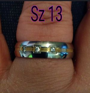 Silver and gold band with 3 stones. Sz 13. Made of stainless steel. for Sale in Glen Burnie, MD