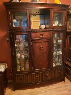 Solid cherry wood curio cabinet with storage for Sale in Macomb, MI