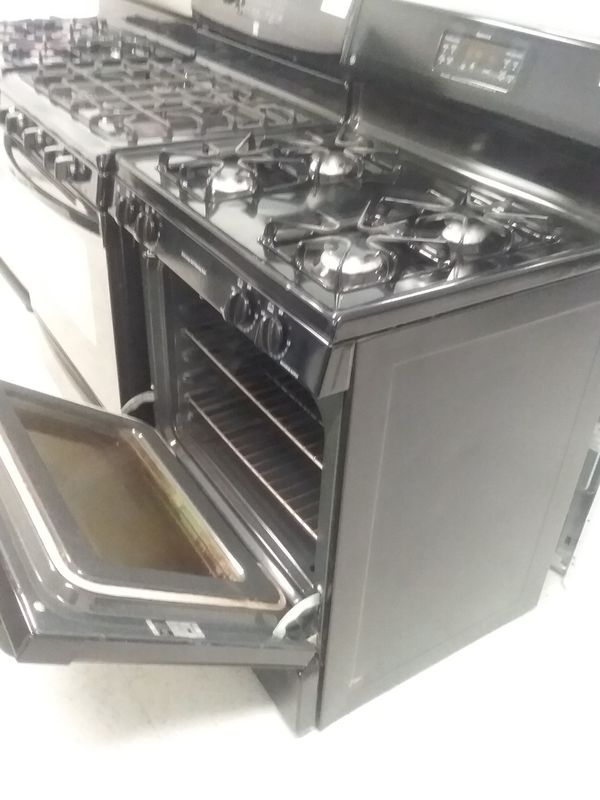 Whirlpool gas stove stainless steel used good condition 90days warranty