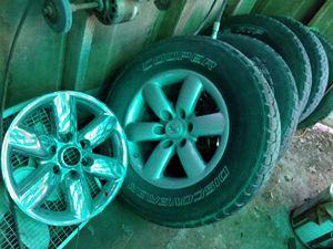 Nissan titan wheels n tires w chrome snap ons for Sale in Abilene, TX