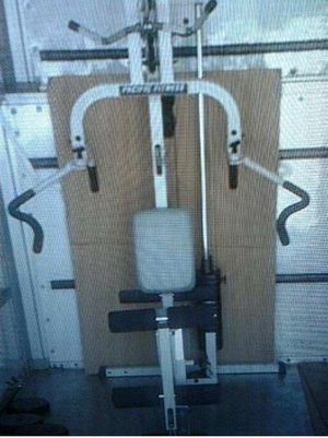 Home gym exercise machine (Pacific fitness) close a barbell and weights for Sale in Irving, TX