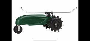 Orbit traveling cast-iron sprinkler tractor for Sale in Glendale, AZ