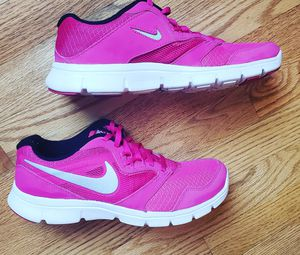 Nike pink and white running shoes size 6 for Sale in Rolesville, NC