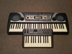 Used M-Audio Oxygen 25 Key MIDI Controller and yamaha portatone psr 260 electronic keyboard for Sale in Oakland, CA