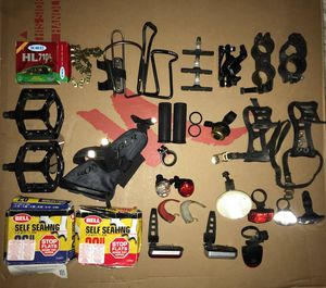Bunch of Bike Lights, pedals, chain, Resealable tubes, bottle holder, for Sale in New York, NY