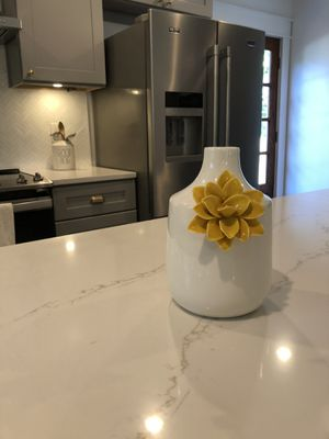 White ceramic vase with yellow flower for Sale in Tampa, FL