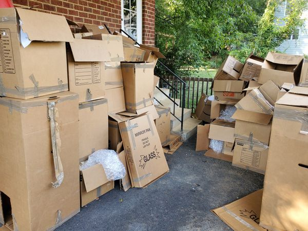 Empty Moving Boxes and Paper Wrap
