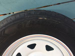 1 - trailer tire. 1 - Transporter St Radial St 205/75R15 Steel belted radial 5 lug wheel. for Sale in Wildomar, CA