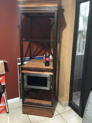 Wood and glass cabinet. Used as a bar. for Sale in Davie, FL