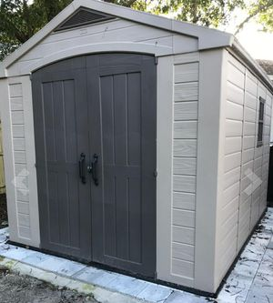 Keter Factor 8x11 Foot Large Resin Outdoor Shed with Floor for Patio Furniture, Lawn Mower, and Bike Storage, Taupe & Brown for Sale in Las Vegas, NV