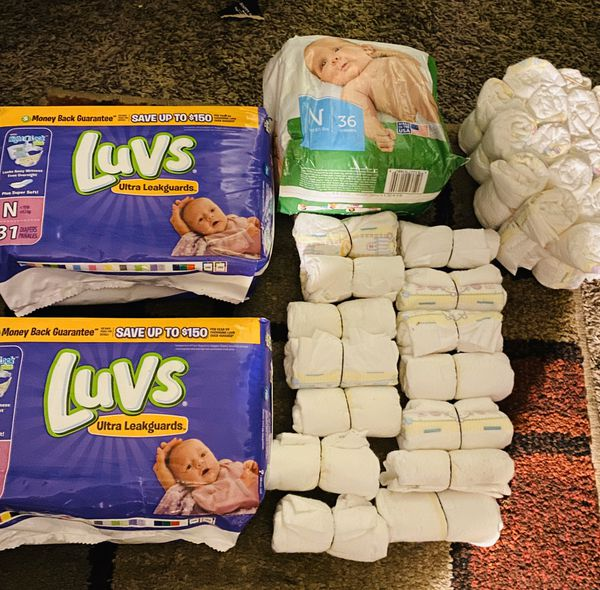 120 newborn diapers luvs ,pampers and store brand