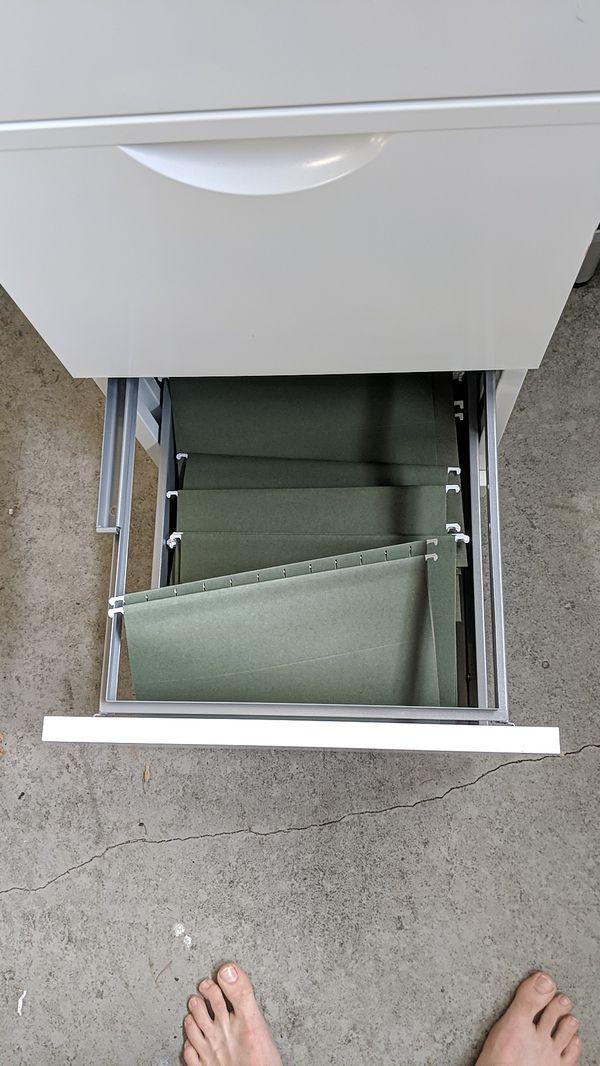 White metal file cabinet