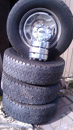 BF Goodrich Tires w/ Rims and Hub Caps w/ 8 lugs for Sale in Hayward, CA