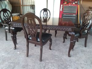 Black cherry dining table with,4 matching chairs,1 leaf ,2 Capt 2 regular , Black leather seats for Sale in Glendale, AZ