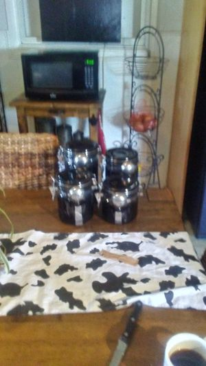 Four black canisters with spoons for Sale in Fontana, CA