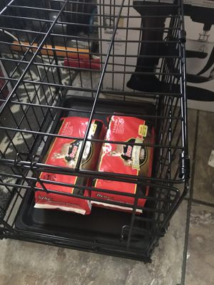 XS dog crate and doggie diapers for Sale in Baltimore, MD