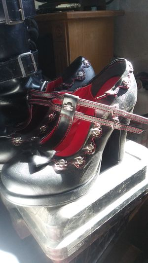BRAND NEW(NO BOX INCL.)Size 9 women. Black & Red Demonia Ladies Heels with Skull and Cross Bones & 2 Straps. (No box) for Sale in Las Vegas, NV