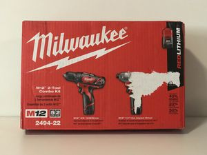 MILWAUKEE M12 CORDLESS COMBO KIT IMPACT,DRILL TWO BATTERIES AND CHARGER for Sale in San Bernardino, CA