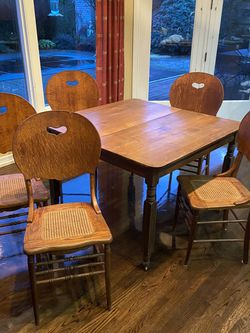"5 Antique Chais With Heart Detail On Back And Caned Seats And Antique 42"" Tablw for Sale in West Linn,  OR"