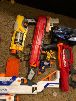 Nerf guns, mini figures and a car for Sale in Vancouver, WA