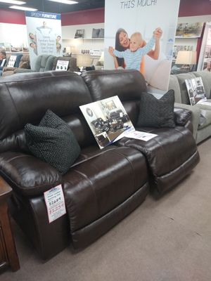 Ashley leather power adjustable headrest and reclining sofa for Sale in Uniontown, PA