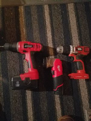 Tool shop power drill small Black and Decker lithium battery drill and Milwaukee's battery power flashlight for Sale in Indianapolis, IN