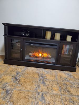 TV Stand with Fireplace & added picture frames for Sale in Queens, NY