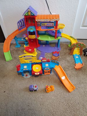 Vtech happy paws playland & lift & fix repair shop go go smart wheels for Sale in Ocala, FL