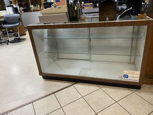 "60"" long by 26"" glass shelves fluorescent light. Top is glass also. $175.00 for Sale in Dallas, TX"