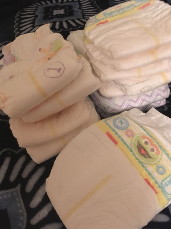 Ten Pampers newborn and size 1