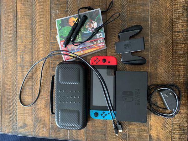 Nintendo switch console with case , 4 games , Zelda, super smash bros ultimate, mortal combat, street fighter anniversar