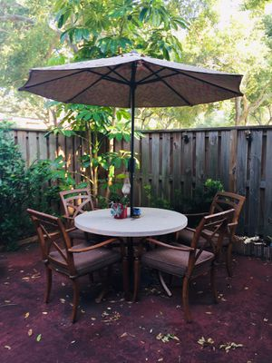 Patio table with umbrella & 4 chairs for Sale in Palm Harbor, FL