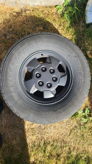 Chevy wheels and tires 6 lug black for Sale in Seattle, WA