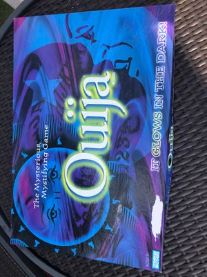 Ouija glow-in-the-dark board game for Sale in Fogelsville, PA