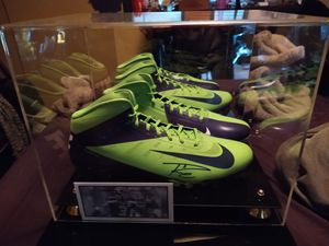 Russell Wilson autographed Nike cleats with display case for Sale in Wenatchee, WA