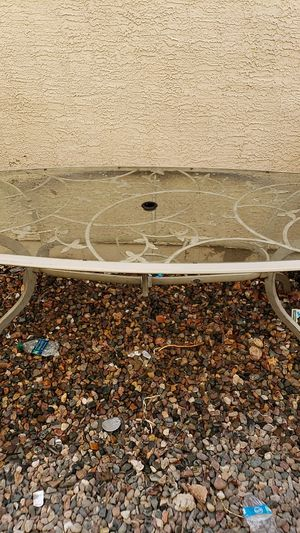 Glass top patio table with umbrella hole. for Sale in Tempe, AZ