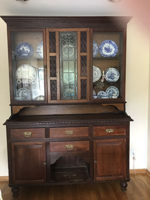Antique hutch with glass front, four drawers and two cabinet areas. Excellent condition. Decorative leaded glass. Solid oak. Buyer to transport. $500 for Sale in Bellevue, WA
